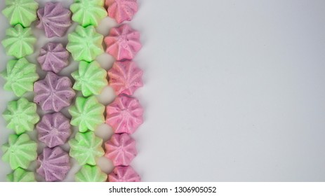 Pattern with meringues on a white background. Multicolored meringues on a white background. Meringue banner. background