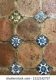 The pattern of Mexican terracotta and talavera tile flooring in Puebla, Mexico.