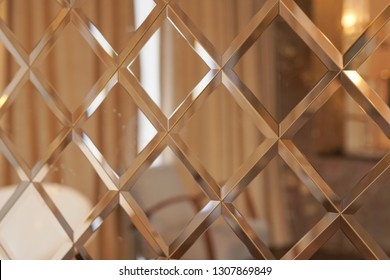 the pattern of mosaic square mirror tiles