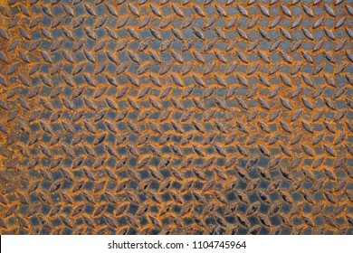 Pattern of old metal diamond plate, Surface of black steel floor non-skid with rusted, Texture background