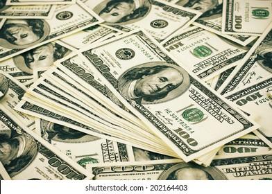 Pattern of one hundred dollar bills pile.