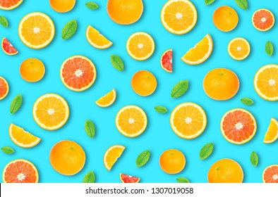 Pattern of an orange citrus slices on bright blue background