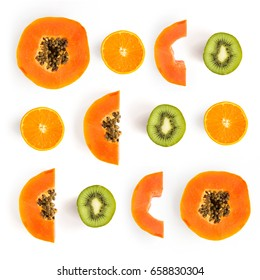 Pattern with papaya, kiwi and orange. Tropical abstract background. Papaya, kiwi,orange on the white background.
