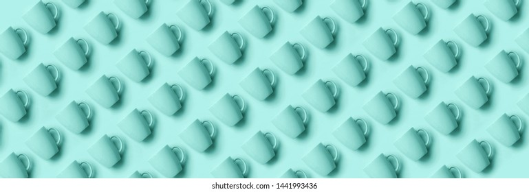 Pattern from pastel cups over trendy blue color background. Birthday party celebration, baby shower concept. Pastel colors. Banner. Minimalist style design.
