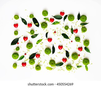 Pattern with petals of chrysanthemum flowers, ficus leaves, hearts and ripe rowan on white background. Overhead view. Flat lay.