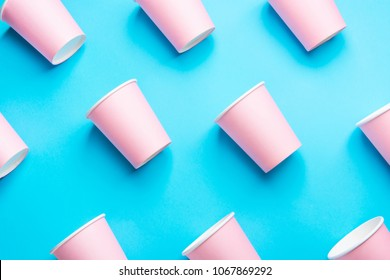 Pattern from Pink Paper Drinking Cups Arranged Diagonally on Mint Blue Backgrounds. Birthday Party Celebration Abstract Fashion Baby Shower Concept. Pastel Colors. Minimalist Style