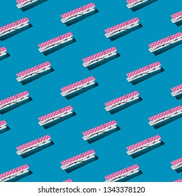 Pattern of pink polka-dots clothespins on blue background.