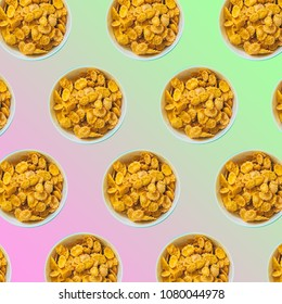 pattern of plates with corn flakes for breakfast on gradient color background. minimal art concept of the 80s and 90s