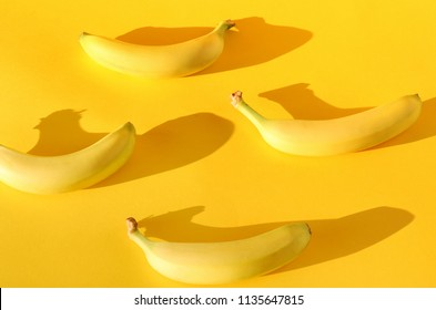 Pattern of real, ripe bananas on a bright, colorful yellow background