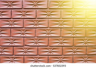The pattern red brick new wall background, An asterisk in the center of brick. light on the brick wall