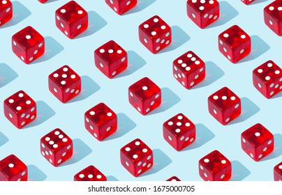 Pattern of red dices on blue background.