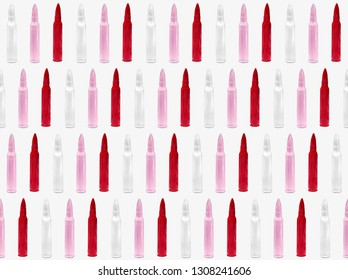 Pattern of red pink and white bullets on white background.