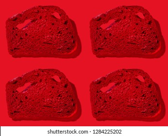 Pattern of red slices of bread on red background.