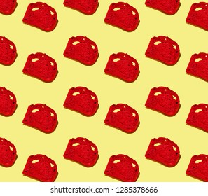 Pattern of red slices of bread on yellow background.