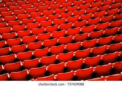 Pattern of red stadium seat.