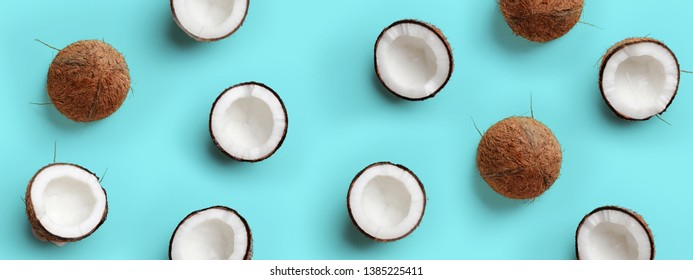 Pattern with ripe coconuts on blue background. Pop art design, creative summer concept. Banner. Half of coconut in minimal flat lay style