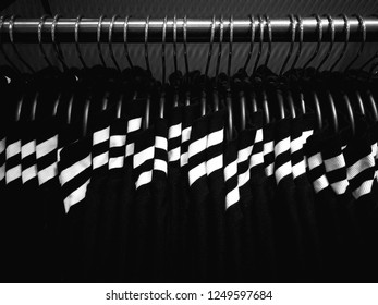 Pattern of row of black and white clothes on hanger