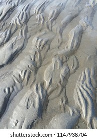 Pattern of sand on beach at low tide