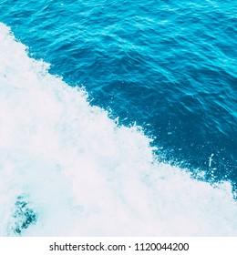 pattern of sea or ocean waves with foam. minimal.