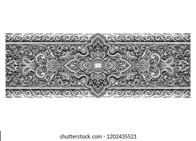 Pattern of silver metal plate with flower carved on white background