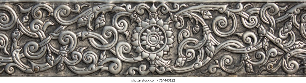 Pattern of silver metal plate with flower carved background, Thai style in temple