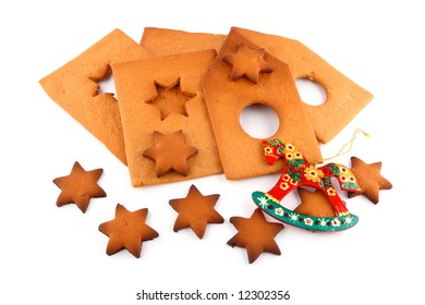 pattern of spice-cake house, sweet stars and red horse