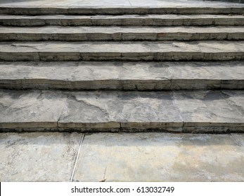 Pattern of stone concrete step stairs foot path, walk way. Close up to texture from fist step, line up to the top like successful way to climb up