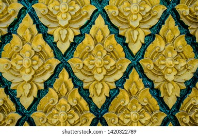 Pattern of stucco art low relief on wall