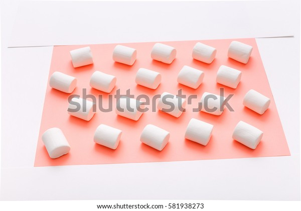Pattern sweet marshmallow, candy on pink background, top view flat lay. Isolated minimal concept above decoration, view marshmallow, food background