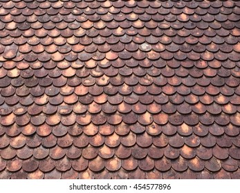 pattern of the tiles on the roof of the temple in Thailand