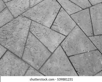 Pattern of trapezium or trapezoid concrete walkway paving slabs