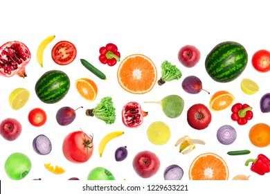 Pattern of vegetables and fruits. Food background Top view Composition of plums, peppers, cucumbers, green radish, tomatoes, apples, banana, lemon and orange, watermelon, pomegranate isolated on white