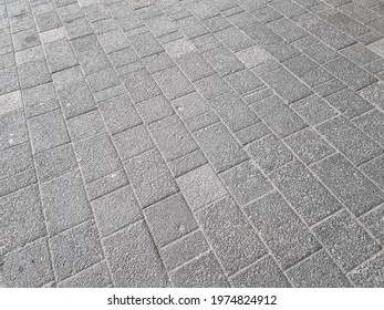 The pattern of the walkway on the concrete road in the parking area in the mall.