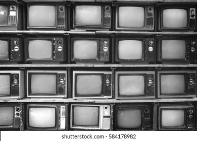 Pattern wall of pile black and white retro television (TV) - vintage film grain filter effect style.