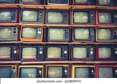 Pattern wall of pile old retro TV ,With vintage filter effect style.