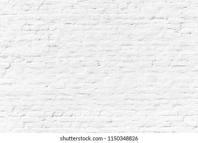 pattern of white painted brick wall gives a harmonic neutral background