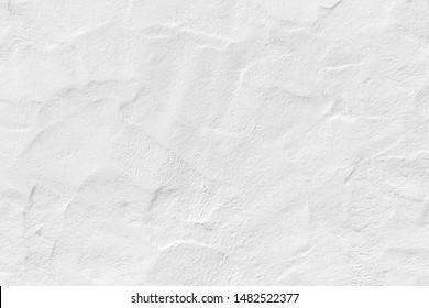 Muster der weißen Gipswand in grobem Aufbau