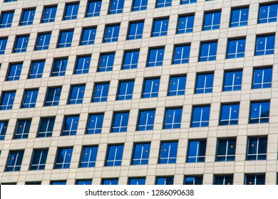 Pattern of windows and room in building.Glass grey square Windows of modern city business building skyscraper.architectural details and geometric constructions