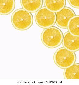 pattern of yellow lemon slices on white Background