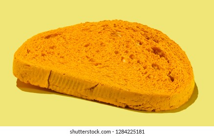 Pattern of yellow slices of bread on yellow background.