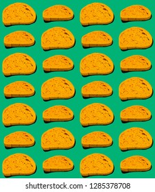 Pattern of Yellow slices of bread on Green background.