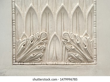patterned bas-relief on white wall. Beautiful design bas-relief with stucco mouldings roccoco element, geometric shape. Elements of ornament for use as a texture or background. copy space.
