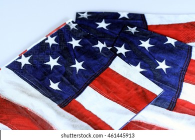 Patterned napkins of red, white, and blue with stars and stripes of the American flag representing independence, freedom, and unity