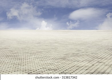 patterned paving tiles with blue sky background