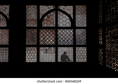 Patterned stone screen window of old Indian palace in Fatehpur Sikri, Uttar Pradesh, India.
