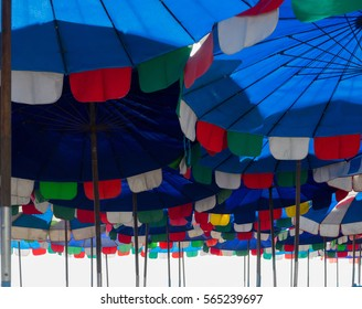 Patterns of colorful beach umbrellas on white background.