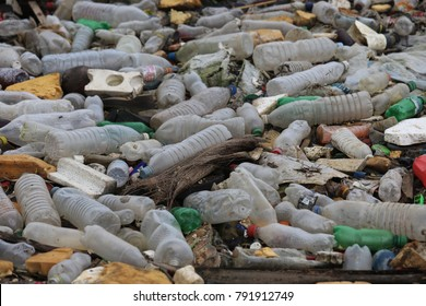 Patterns of floating plastic battles on the water. Symbol of pollution and destruction of the planet. Polluted dirty surface by waste and residues produced by people. Environnemental problem.