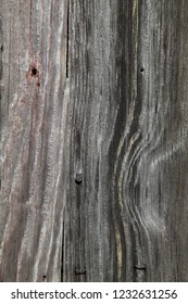 Patterns in the oak walls of an old, abandoned barn for background uses