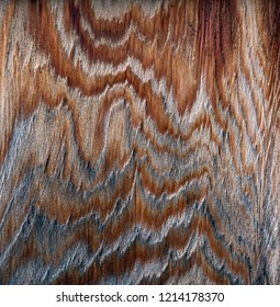 Patterns on an old cedar board close up.