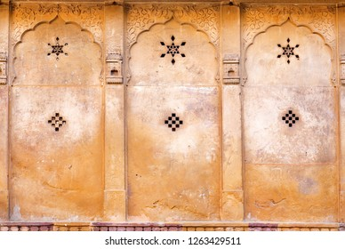 Patterns with stars on wall of historical house in Rajasthan, India